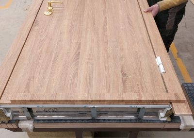 assembling Munitus security door with flat PVC panels