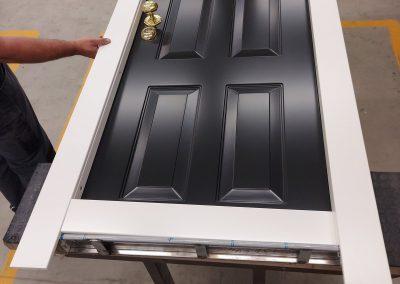 Munitus security door with shiny brass knob