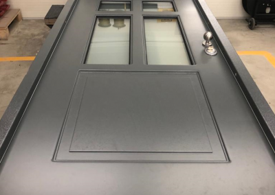 Munitus security door with WRB panels and P6B glass