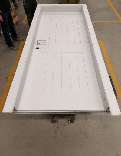 white Munitus security doors with 10 F millings