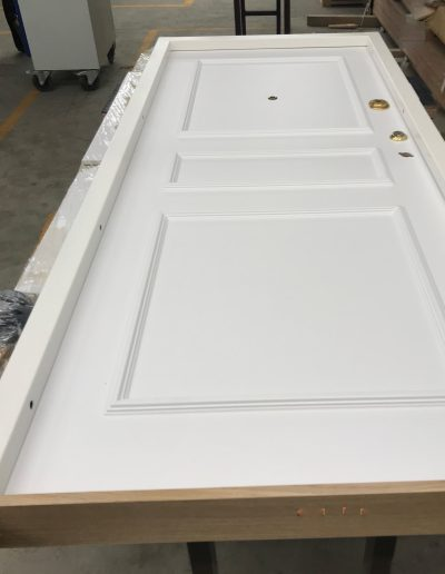 Munitus Security door with wood threshold