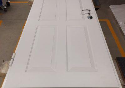 Munitus security door with painted panel