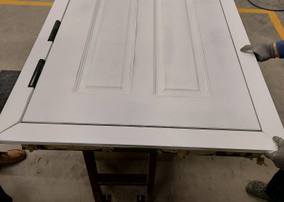 assembly of Munitus security doors with panels prepared for painting