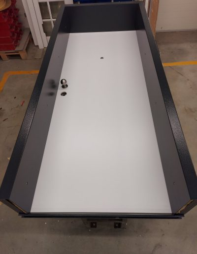 Munitus security door with width frame.
