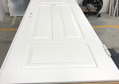 Munitus security door with MF milling panels and oak thershold