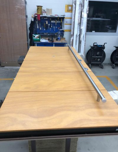Munitus security door with natural plywood panels in assembly