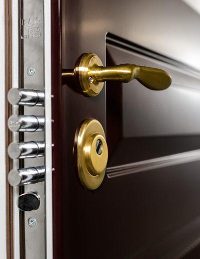 Munitus security door with brass handles