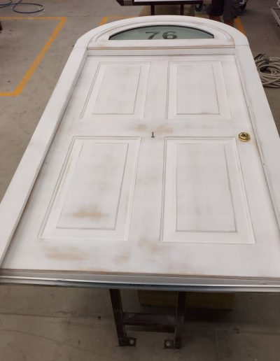security door with arche and panels prepared for paiting