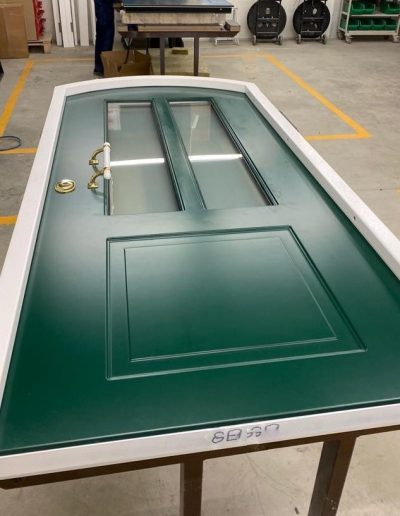 Arched custom made security door with glass