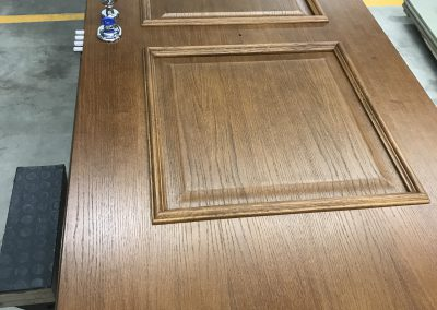 security door with natural plywood panels