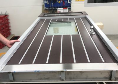 Security door with stainless steel lines and transom