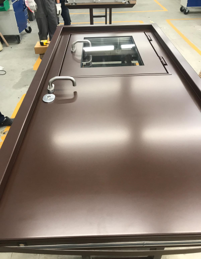 security door with flat steel panels and opening window