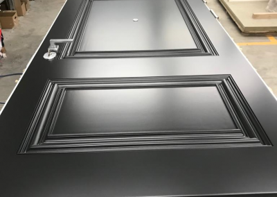 Munitus security door with painted panels and special custom made milling