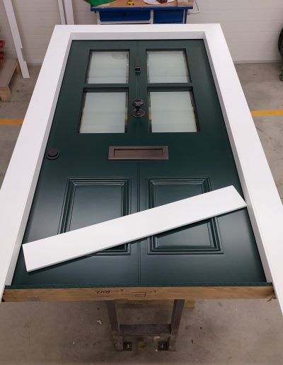Victorian style Munitus security door with mat glass
