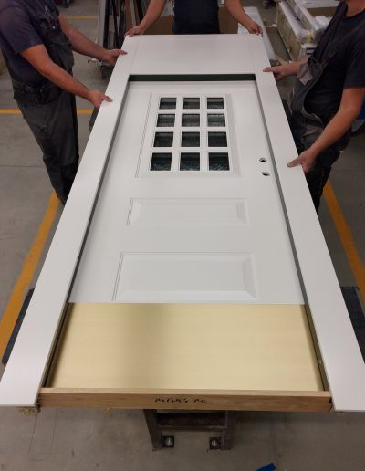 Danish style Muitus security door with glass and transom and kick plate.