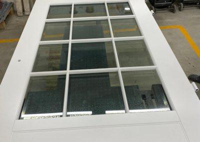 Glazing Munitus security door with post box