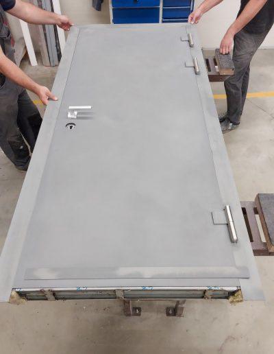 Bullet proof Munitus security doors with steel panels prepared for painting