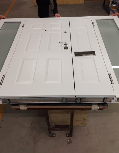 Double Munitus front security door with sidelights