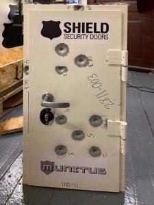 Munitus FE5 FB4 ballistic resistance test door after the tests - front side.